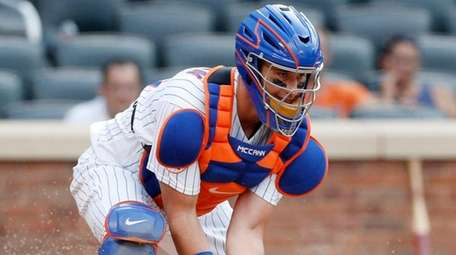 James McCann of the Mets fields the ball