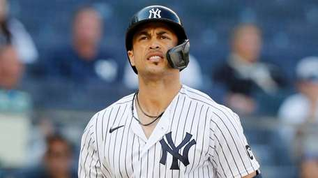 Giancarlo Stanton of the Yankees strikes out in