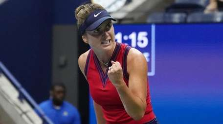 Elina Svitolina pumps her fist after getting point