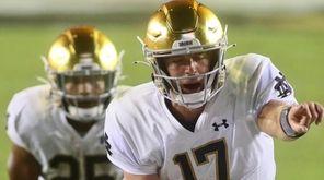 Notre Dame quarterback Jack Coan (17) motions in