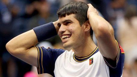 Carlos Alcaraz  celebrates after defeating Stefanos Tsitsipas