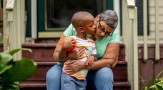 Christina Colman, 60, of Coram, sits on the