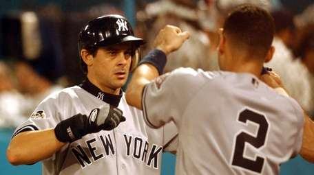 Yankees third baseman Aaron Boone is greeted by