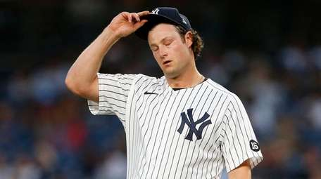 Yankees starting pitcher Gerrit Cole reacts after giving