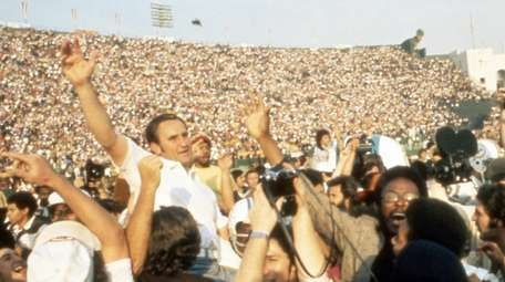Miami Dolphins head coach Don Shula is carried