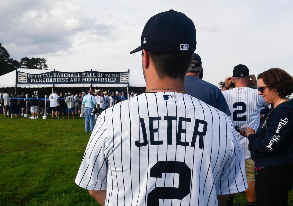 Fans wait in line to purchase baseball merchandise