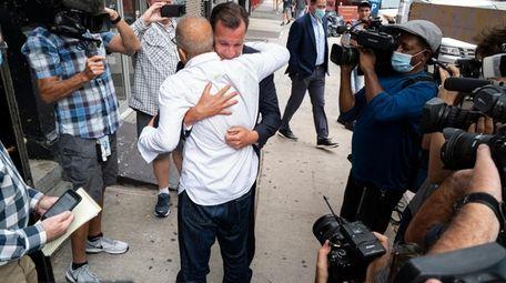 Rep. Tom Suozzi (D-Glen Cove) embraces Mohammad Wali