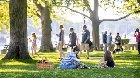 Picknickers and strollers enjoy Northport Village Park in