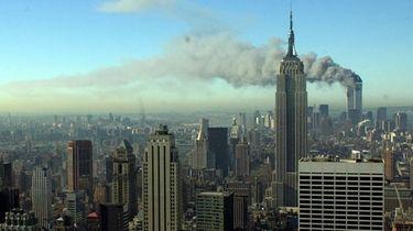 Smoke billows across the New York City skyline