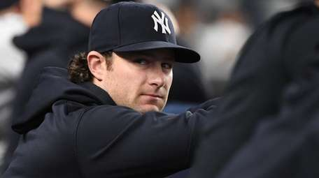 Yankees pitcher Gerrit Cole looks on from the