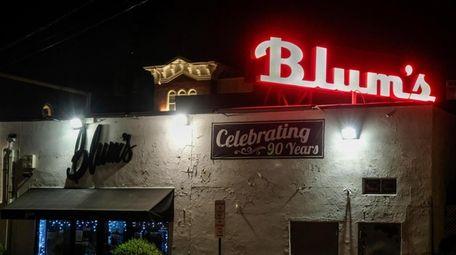 The neon sign behind Blum's Swimwear & Intimate