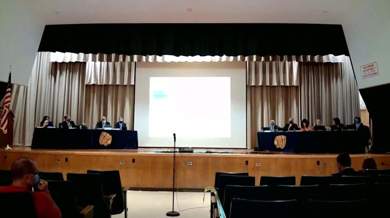 Massapequa school board trustees at a meeting Thursday