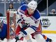 The Islanders' Anthony Beauvillier fights for control of