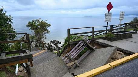 A damaged staircase at Callahans Beach in Fort