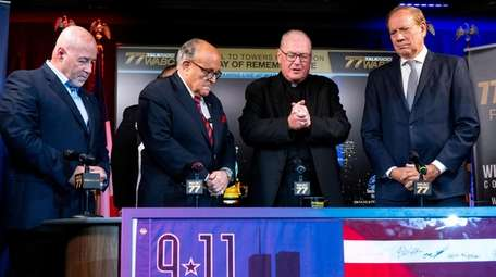Cardinal Timothy Dolan, third from left, says a