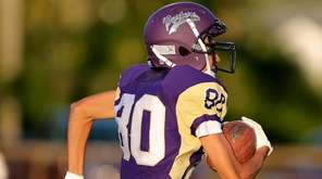 Greenport WR Kaiden Fisher grabs the pass over