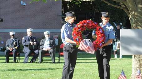 A wreath-laying ceremony Saturday at the Southampton Fire