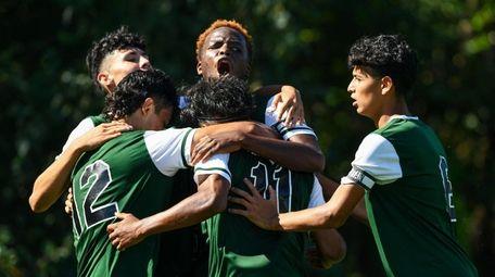 David Akpan (center) celebrates his goal second-half goal,