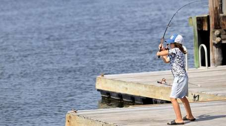 Odin Farid fishes off the dock at the