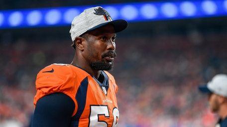 Von Miller of the Broncos walks in the