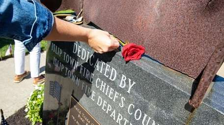 A rose is placed on the 9/11 memorial