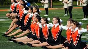 Carey's kickline performs during halftime at H. Frank
