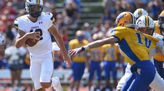 Ryan Heidrich #12, Massapequa quarterback, runs the ball