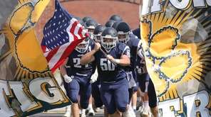 Northport's Andrew Canales (50) bursts through the banner