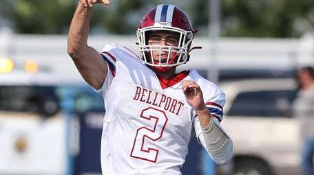 Bellport's Jack Halpin throws a pass in the