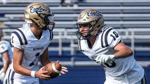 Bethpage quarterback Luke Galgano fakes the handoff to