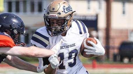 Brian Luzzi of Bethpage gets pushed out of