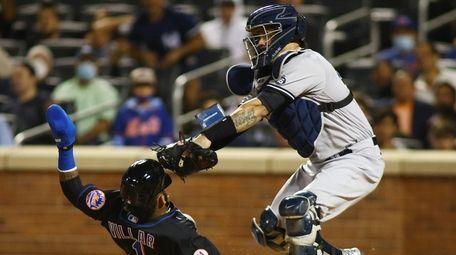 Jonathan Villar of the Mets scores under the