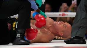 Tito Ortiz lies on the mat after being