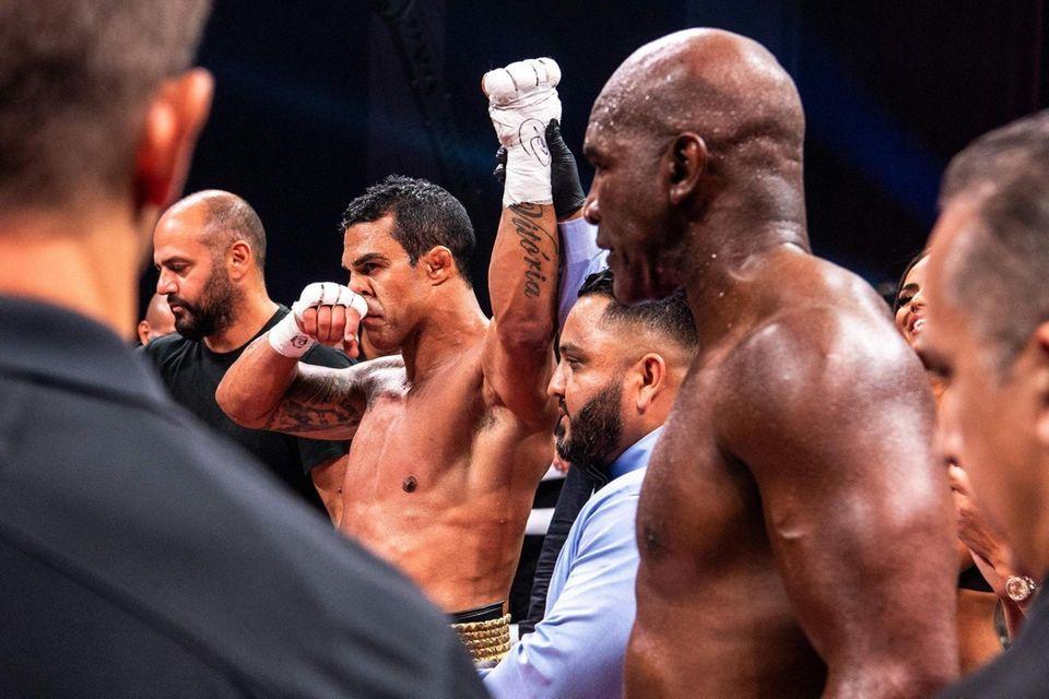 Brazilian martial artist Vitor Belfort (3rd L) celebrates