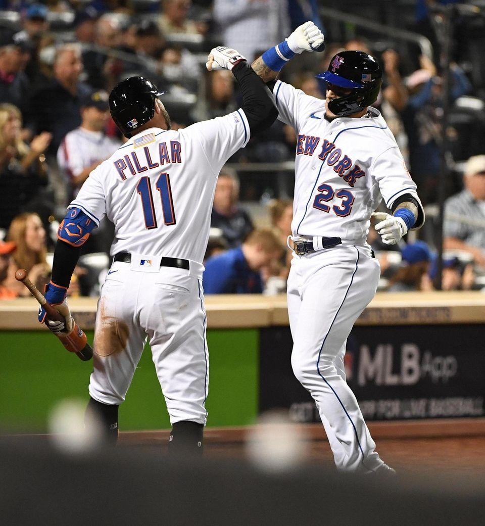 New York Mets' Javier Baez is greeted by