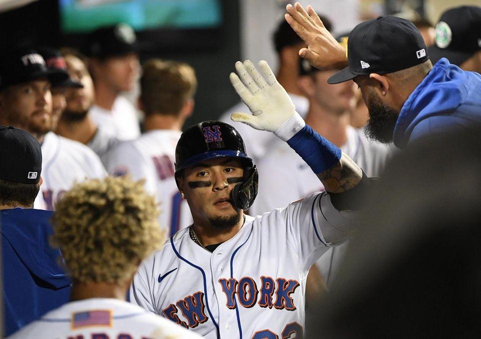New York Mets' Javier Baez is greeted in