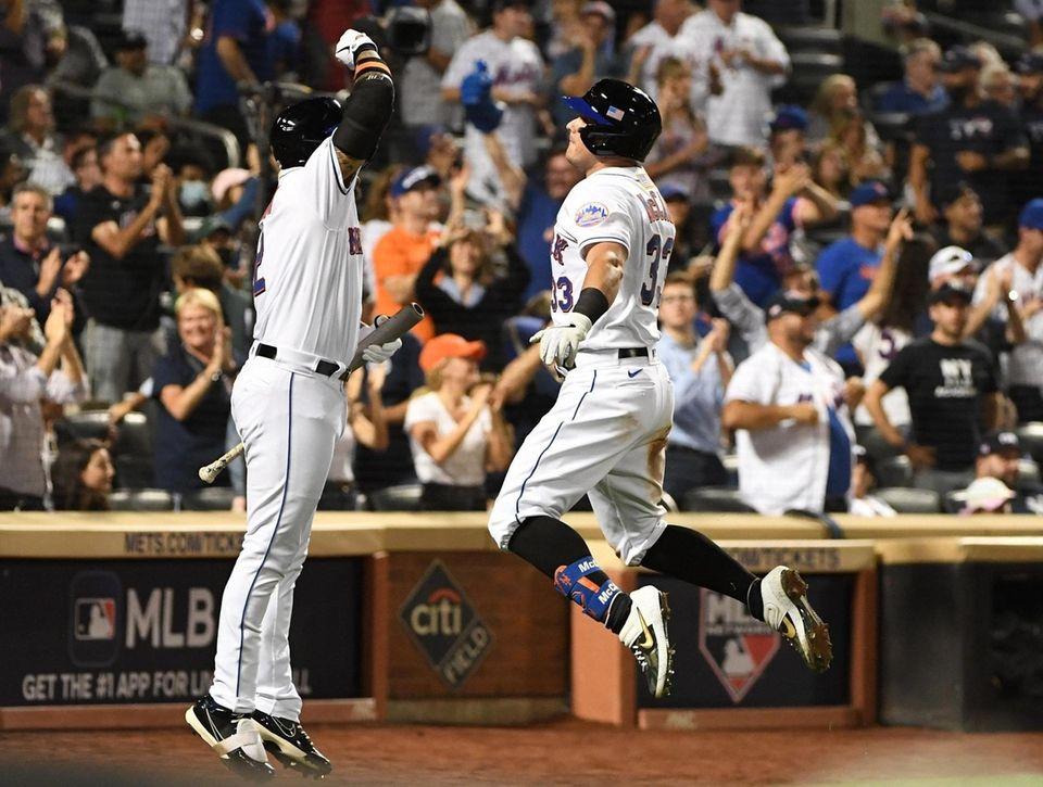 New York Mets catcher James McCann is greeted
