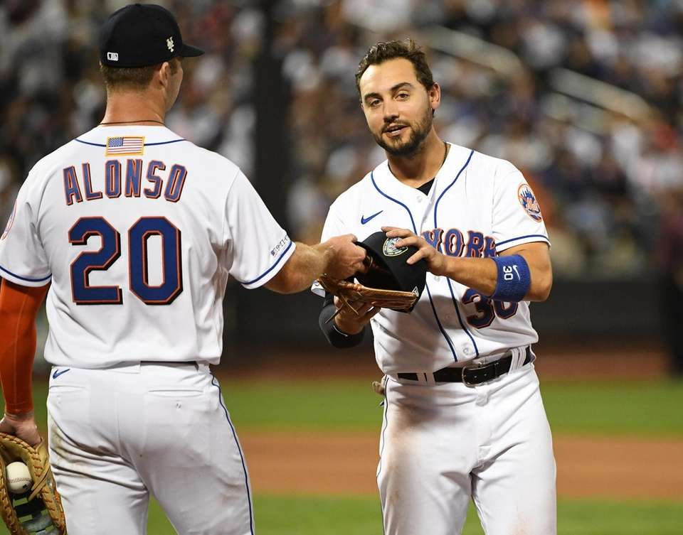 New York Mets' Pete Alonso hands a first