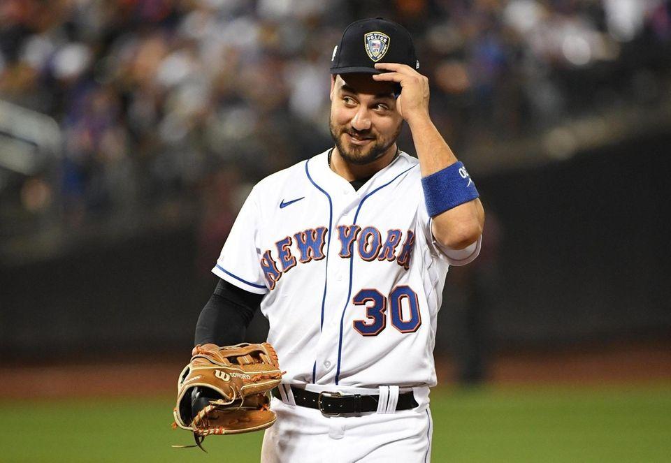 New York Mets right fielder Michael Conforto wears