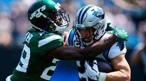 Carolina Panthers running back Christian McCaffrey is tackled