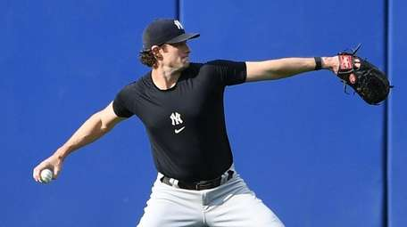Yankees pitcher Gerrit Cole throws in the outfield