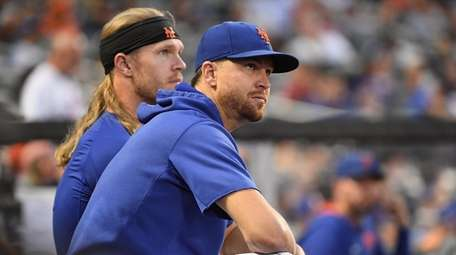 Mets pitchers Jacob deGrom and Noah Syndergaard look