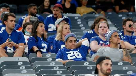 Giants fans look on late in the fourth