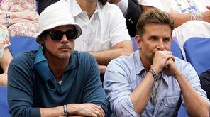 Brad Pitt, left, and Bradley Cooper watch play