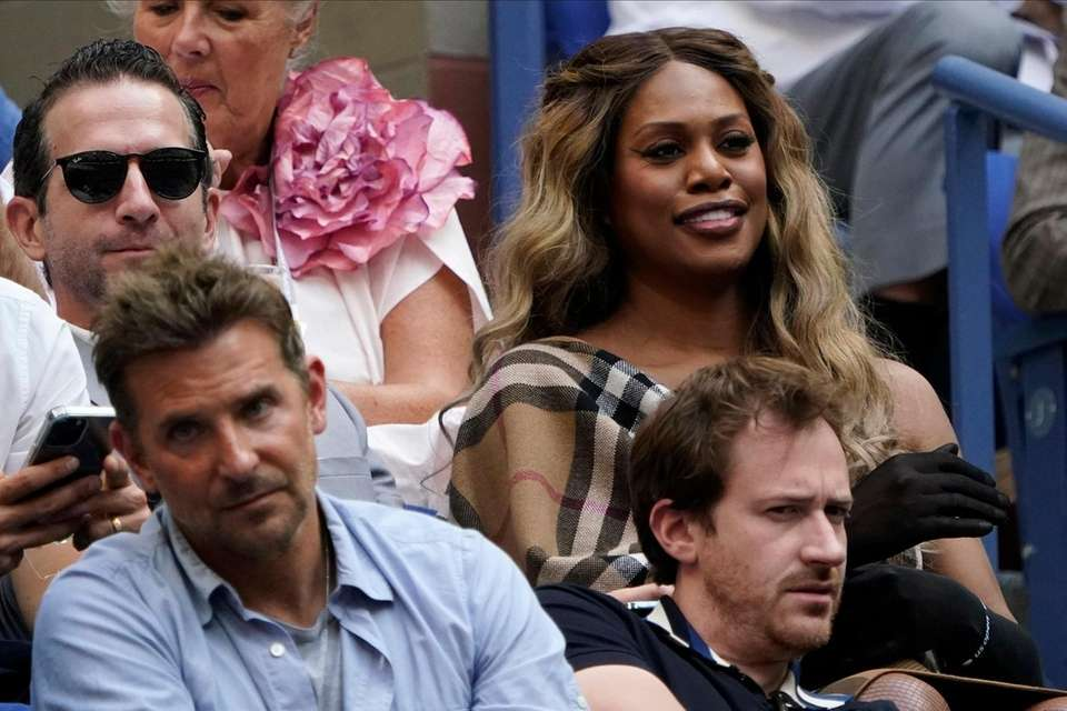Laverne Cox, upper right, watches play between Novak