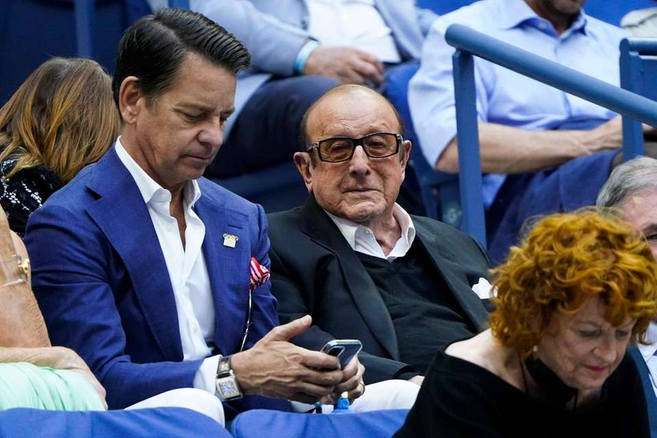 Record producer Clive Davis, right, watches play between