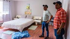 Broker Jeewan Persaud, left, chats with homeowner Derek