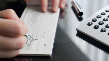 Financial planners say keeping two separate checkbooks and