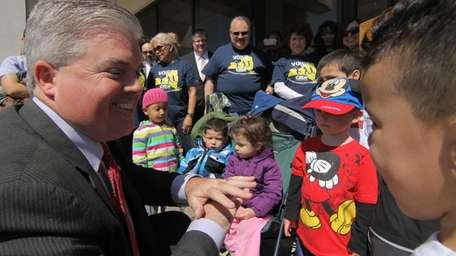 Suffolk County Executive Steve Bellone talks with children