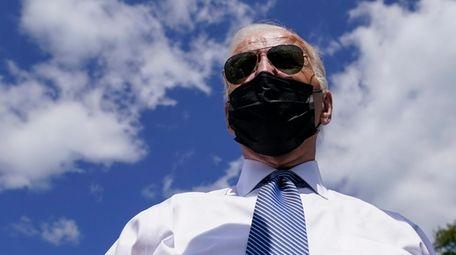 President Joe Biden speaks to members of the